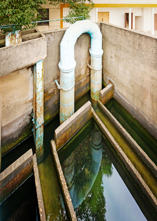 turbidity: blue pipeline for oxygen blowing into sewage water  Stock Photo