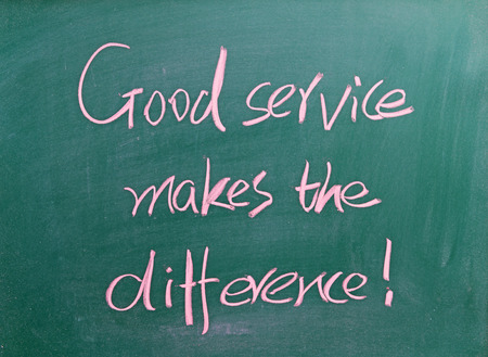 good service: Good service makes the difference written on chalkboard Stock Photo