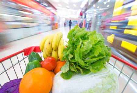 Supermarket interior, filled with the fruit and Vegetables of the shopping cart