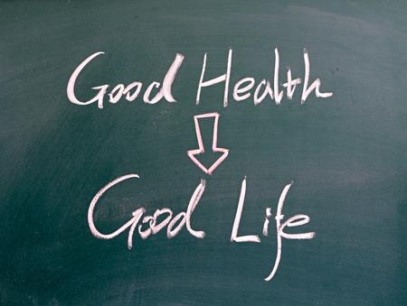 social behaviour: good health and good life word written on blackboard Stock Photo
