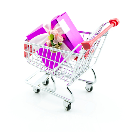 Shopping cart and giftbox on white