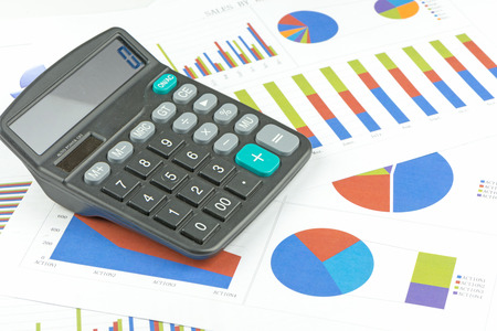 calculator on paper table with diagram Stock Photo