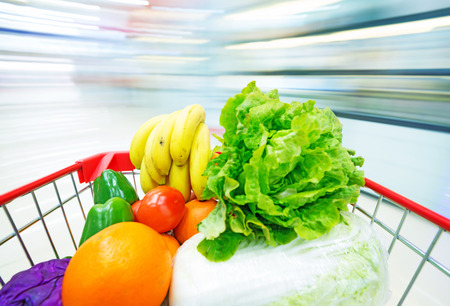 filled with the fruit and Vegetables in the shopping cart Stock Photo