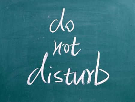 Do Not Disturb written by hand on chalkboard Stock Photo