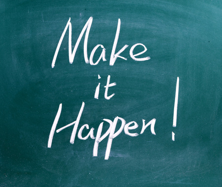 make known: Make It Happen written on chalkboard. Used in business, life and sports coaching this well known phrase or saying has become a rallying cry for getting things done. Stock Photo