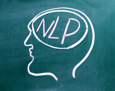 Drawing on chalkboard of a human head in profile with NLP on the brain. NLP is the acronym for Neuro-Linguistics Programming, often used in business and Psychotherapy for self improvement. Stock Photo - 80332746