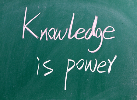 Knowledge is power written on chalkboard