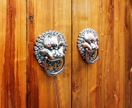 constitute: Ancient Chinese door knocker, located in Temple of Confucius Stock Photo