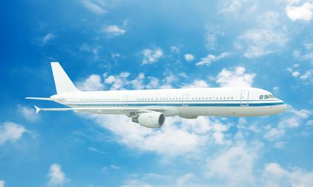 modern business: Large passenger plane flying in the blue sky