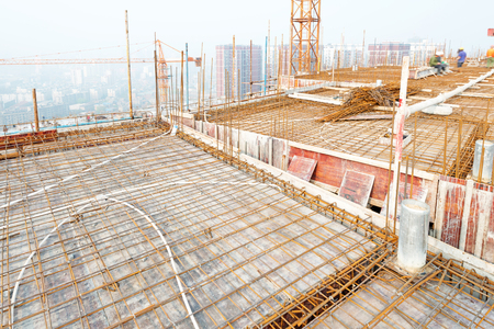 dynamic growth: building under construction with workers