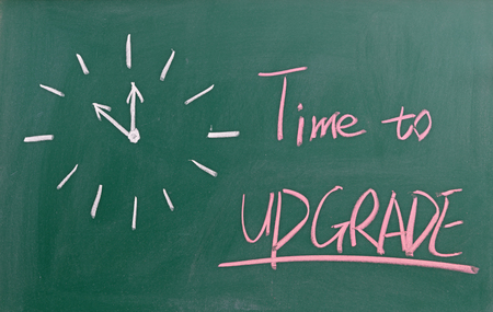 Time to upgrade written on chalkboard 版權商用圖片