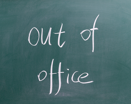 Out of office ! written on chalkboard