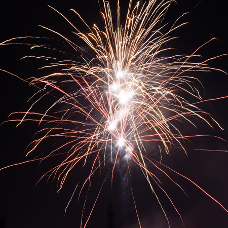 pyrotechnics: Cluster of colorful Fourth of July fireworks. Stock Photo
