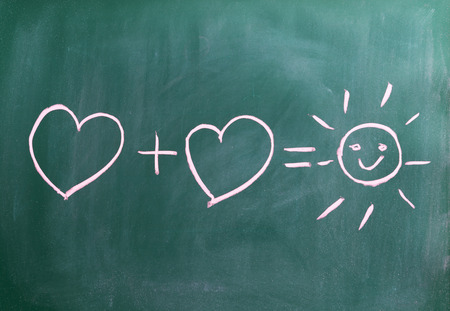 successful relationship two hearts and a sun on chalkboard