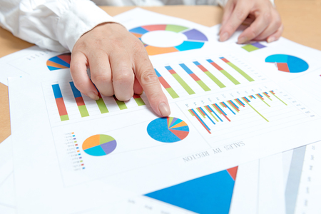 business, office, tax, school and education concept - woman hands with charts and papers Stock Photo