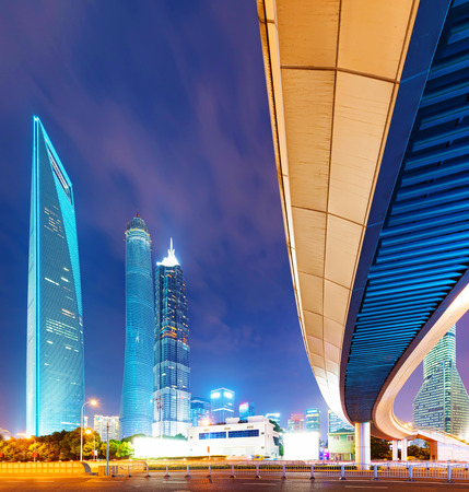 accelerated: the light trails on the modern building background in shanghai china. Stock Photo