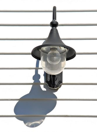 Lantern and its shadow on a white wooden wall Stock Photo - 820038