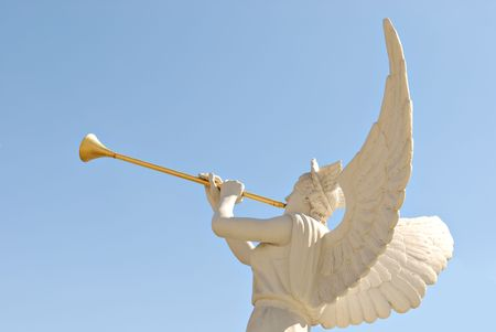 The statue of the angel with golden trumpet photo