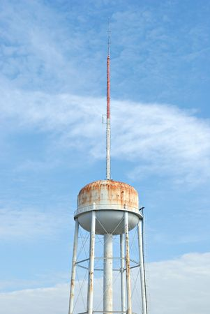 Water reservoir with communication tower on a clear sunny day
