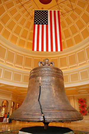 displayed: American heritage bell and flag, proudly displayed Stock Photo