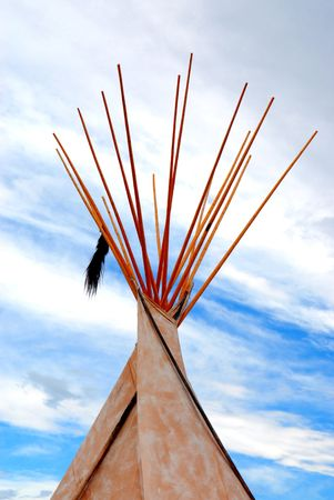 taut: Native Indian tepee - wigwam in front of the blue sky�s and white clouds Stock Photo