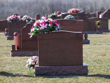 unmarked: Tombstones with bouquets of white, red and blue flowers