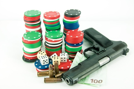 chips for roulette, dice cash and a gun on a white background photo