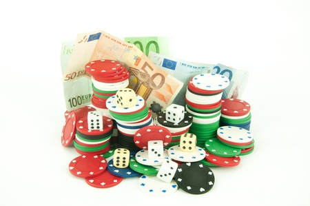 chips for roulette, dice and money on a white background photo