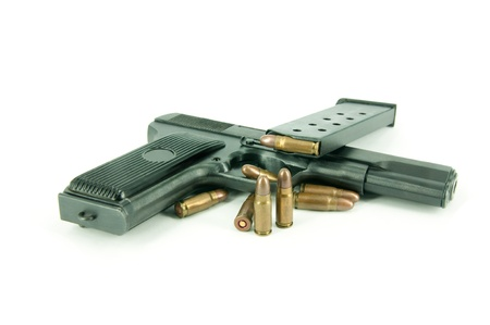 Closeup of  military bullets and gun isolated on white Stock Photo - 11573034