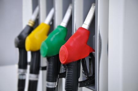 Gasoline pump nozzles at petrol station  写真素材