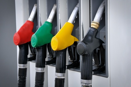 Gasoline pump nozzles at petrol station  Stock Photo