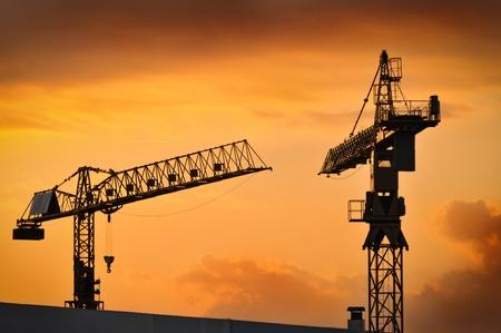 The construction crane on sunset