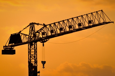 The construction crane on sunset  photo