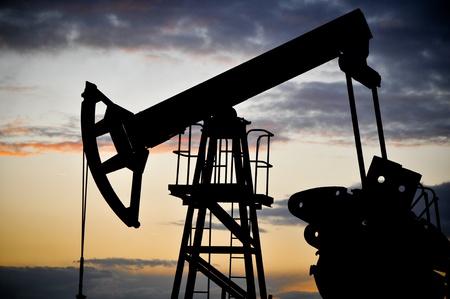Oil pump jack on the sunset