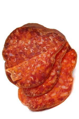 Smoked sausage isolated over a white background photo