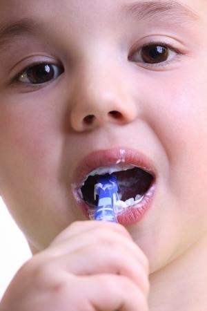 Beautiful little boy to brush his teeth photo