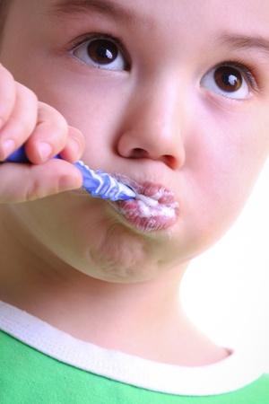 Beautiful little boy to brush his teeth Stock Photo - 12438332