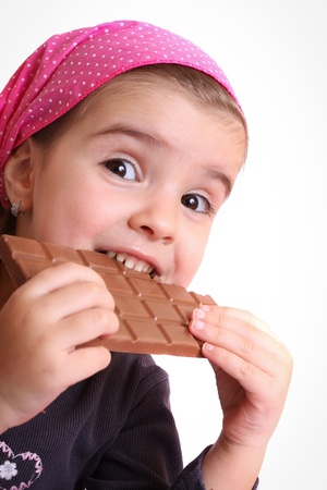 Girls eat chocolate