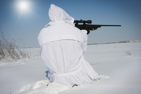 Sniper in white camouflage photo