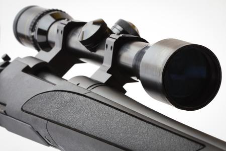 black hunting rifle with optics isolated on white photo