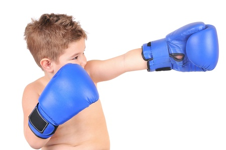 Little boy standing with blue boxing gloves, isolated on white Standard-Bild