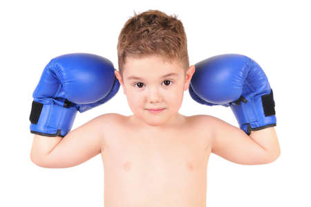 Little boy standing with blue boxing gloves, isolated on white photo