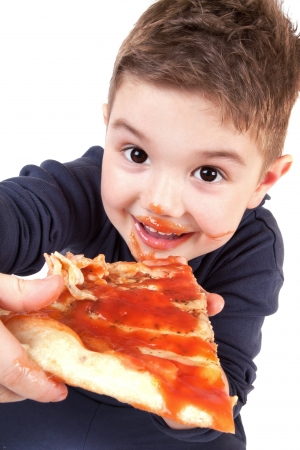 ready to eat: A young boy eating pizza
