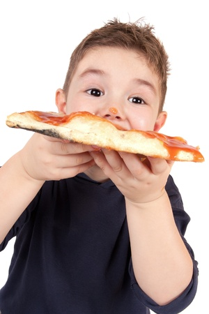hungry children: A young boy eating pizza
