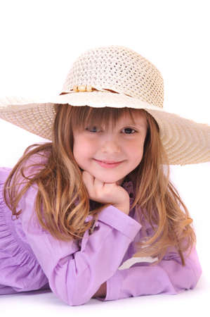 beautiful little girl with long hair and a hat on a white background photo