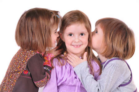 Three girls whisper photo