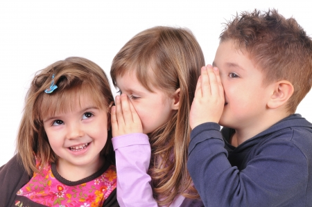 Two girls and a boy gossiping Stock Photo