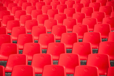 Red empty stadium seats photo