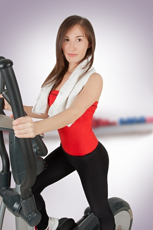 Woman hands on tracking machine in fitness center photo