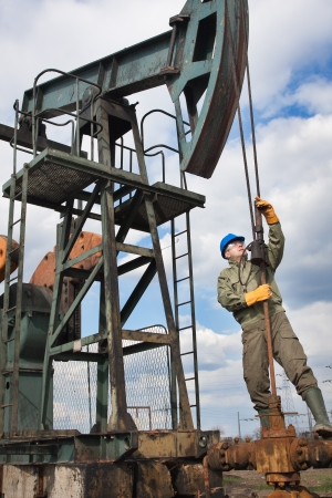 oil field: worker in the oil industry on oil pump Stock Photo